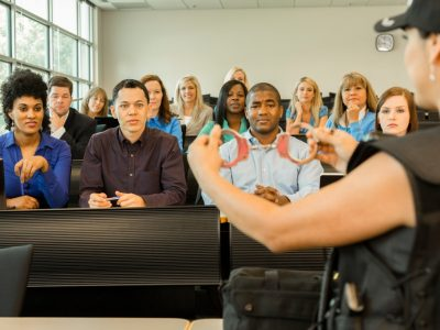 law-policewoman-speaks-to-police-cadets-in-classroom-handcuffs-picture-id486148228